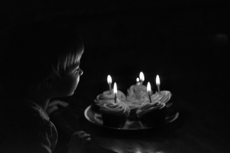 little-girl-blowing-out-birthday-candles-documentary-birthday-party-photographer